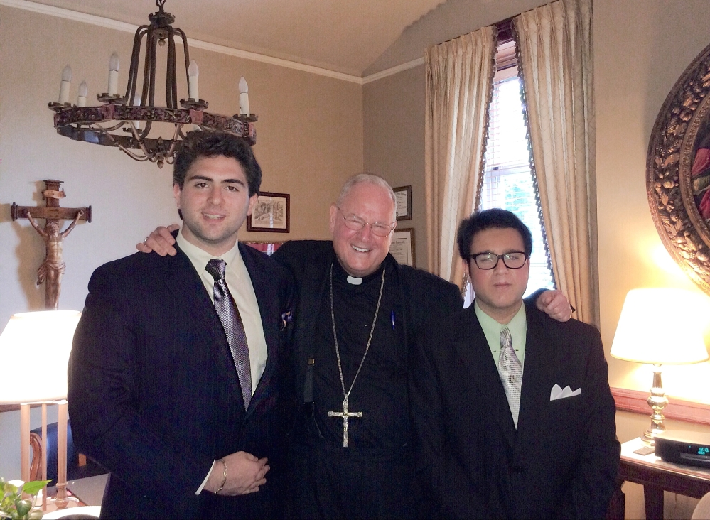Cardinal Dolan (center) with Michael Menconi FCRH '14 (left) and Ken Ochs FCRH '14 (right)