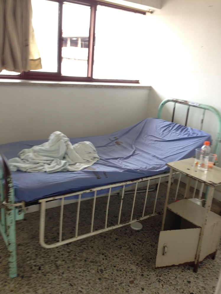 A bed in the hospital in Colombia. Photo by Michael Menconi